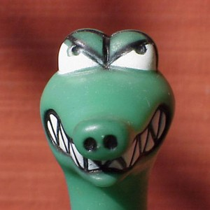 green plastic dinosaur head