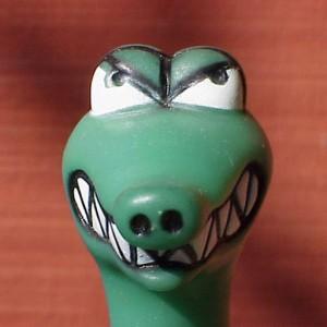green plastic dinosaur head