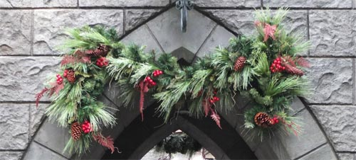 Christmas wreath over stone archway